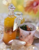 Colourful salad dressing and pesto with peanuts as gifts