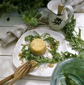 Parmesan flan with rocket