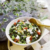 Steamed spinach with walnuts and soft cheese