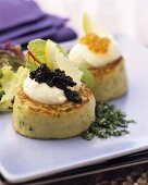 Potato cakes with crème fraiche and caviare