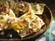 Pasta parcels filled with forcemeat, bacon and spinach