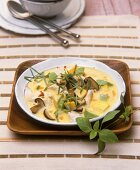Chicken and vegetable laksa (curried dish) with Thai basil