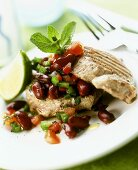 Grilled tuna steak with kidney bean and tomato salad