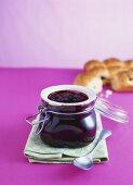 Blackberry jam with star anise, raisin buns behind
