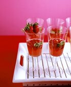 Champagne punch with strawberries and basil