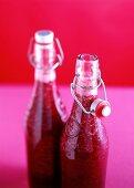 Strawberry pulp in flip-top bottles