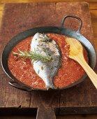 Fish with almonds, white and tomato sauce (con almendras)