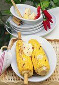 Barbecued corncobs with chili and honey butter