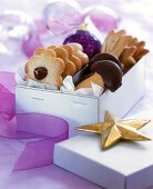 Various shaped marzipan biscuits in cardboard gift box
