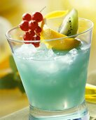 Blue Curacao cocktail garnished with fruit