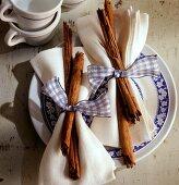 Winter table decoration: napkins with cinnamon sticks