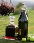 Elderberry liqueur and juice in bottles