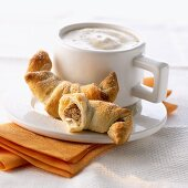 Nut crescents and a cup of cappuccino
