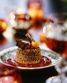Gingerbread pudding on berry sauce