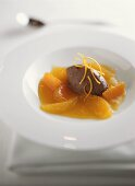 Citrus fruit compote with chocolate ice cream