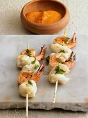 Skewered shrimps with romesco sauce