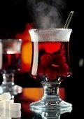 Steaming cherry punch in glass
