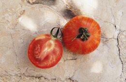 Whole and half tomato, Red Zebra variety