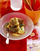 Clear meat broth with gorgonzola dumplings and pears