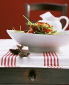 Bread salad with rocket and tomatoes