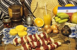 Raw meat kebabs, corn cakes and mate (Paraguay)