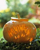 The word 'Halloween' carved in a pumpkin