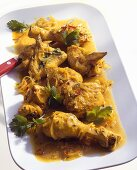 Chicken curry with onions and coriander leaves