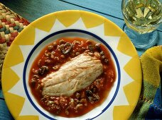 Red snapper with tomatoes, olives and peppers