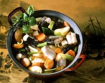 Hamburg eel soup with dried fruit in pot on old picture