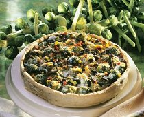 Whole Brussels sprout quiche with pumpkin seeds on large plate