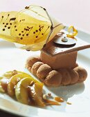 Calvados parfait with wafer decoration and glazed apples