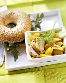 Chicken fillet with fennel and oranges; bagel with rocket