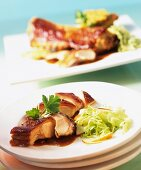 Chine of suckling pig with honey glaze & cabbage & apple salad