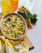 Ribbon pasta bake with courgettes, tomatoes and basil