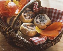 Coiled buns with plum puree in basket; tulips