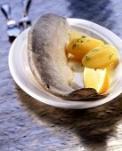 Trout cooked blue with parsley potatoes and lemon
