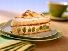 Piece of yoghurt meringue cake with gooseberries