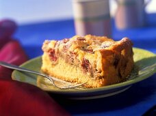 Piece of rhubarb cake with sour cream topping
