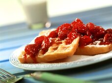 Waffles with strawberry jam with pieces of fruit