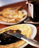 Pancakes with damson puree