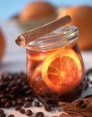 Coffee jelly with orange slices in jam jar