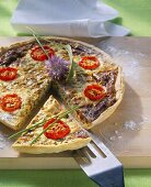 Ramsons (wild garlic) quiche with cherry tomatoes (piece cut)