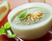 Green rye soup with grated carrots and basil