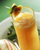 Orange and papaya drink with lemon balm