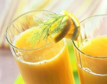 Fennel & carrot drink with pieces of orange & fennel leaves
