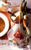 Goulash soup with ingredients (vegetables, meat, bay leaf)