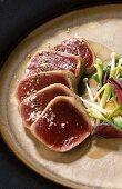 Sautéed tuna fillet, in slices, garnished with vegetables