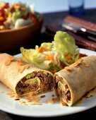Enchiladas with apple and mince filling and lettuce