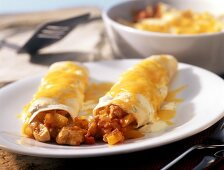 Chicken enchiladas with peppers and cheese
