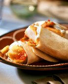 Fish burritos with tomato and caper salsa